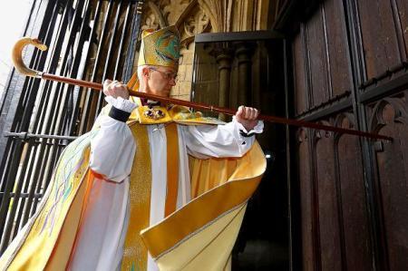Archbishop Welby strikes the door