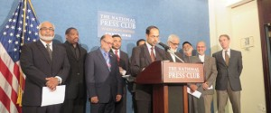 (RNS1-sept24) Nihad Awad, center, executive director of the Council of American-Islamic Relations, and more than 10 Muslim-American leaders Wednesday (Sept. 24) endorse a letter written by more than 100 Islamic scholars that denounces ISIS by relying on sacred Muslims texts. For use with RNS-MUSLIM-SCHOLARS, transmitted on September 24, 2014, Religion News Service photo by Lauren Markoe.